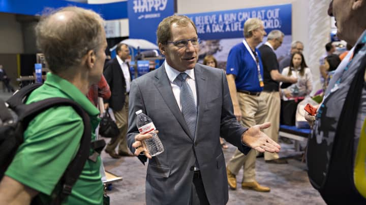 Jim Weber, chairman and chief executive officer of Brooks Sports Inc., center, speaks with attendees on the exhibit floor during the Berkshire Hathaway annual meeting in Omaha, Nebraska, U.S., on Saturday, May 6, 2017.