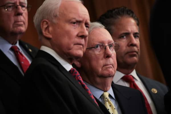 (L to R) Sen. Mike Enzi (R-WY), Senate Finance Committee chairman Sen. Orrin Hatch (R-UT), Senate Majority Leader Mitch McConnell (R-KY) and Rep. Mike Bishop (R-MI) look on during a press event to discuss the GOP plans for tax reform, September 27, 2017 in Washington, DC.