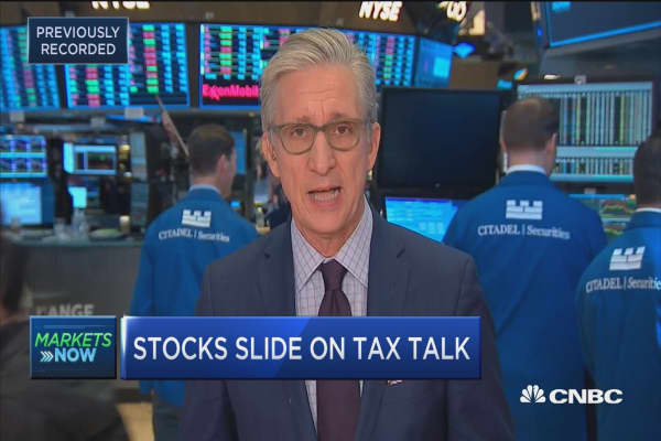 Stocks slide on tax talk