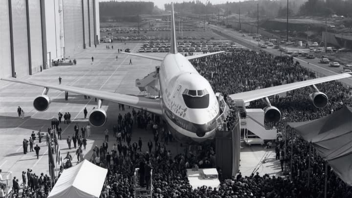 The prototype of the 'Jumbo' being rolled out of its purpose-built factory - the largest building ever built - at Everett, Washington, USA. The world's largest passenger aeroplane, the Boeing 747 carries up to 400 people. The aircraft first entered service in 1970. (Photo by SSPL/Getty Images)