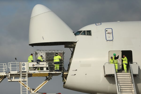 Workers load a shipment of aid on to a Boeing 747 cargo plane at Schoenefeld Airport on November 13, 2013.