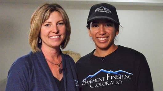 Basement Finishing Colorado co-owner Leslie Soell and Alexis Monserrate, recent graduate of the homebuilding program, who Leslie hired.