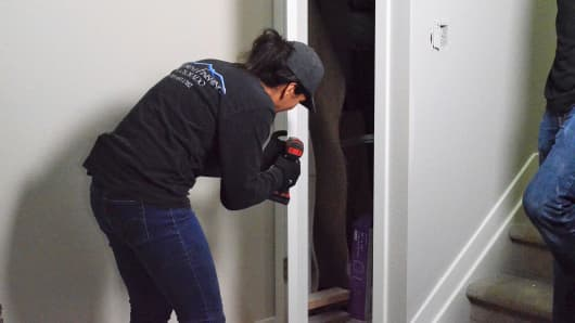 Recent graduate, Alexis Monserrate working on a home.