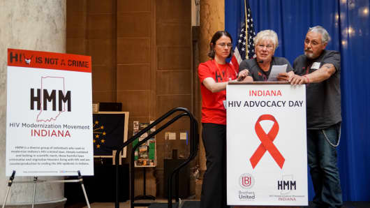 Carrie Foote stands with Travis Spoor's mother as she gives her testimony about how the HIV criminal laws have affected her son and devastated her family at the HIV Modernization Movement advocacy day in Indiana.