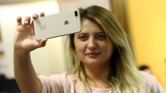 A woman takes a selfie with an Apple iPhone after Apple launched iPhone 8 and iPhone 8 plus at a Vodafone store in Ankara, Turkey.