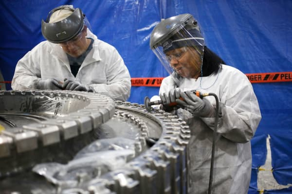 Workers prepare gas turbine parts for installation at the General Electric energy plant in Greenville, South Carolina.
