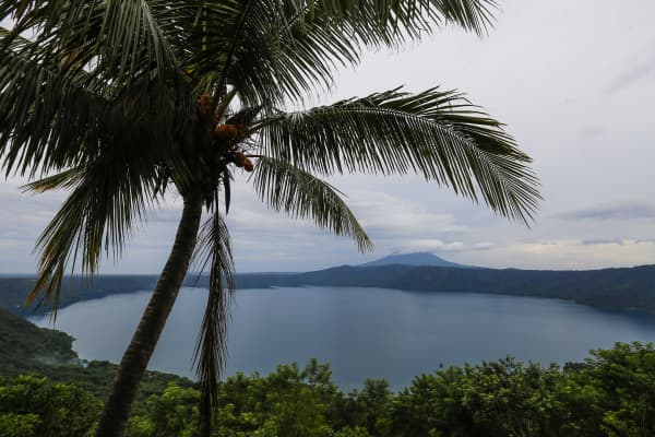 View of 'Laguna de Apoyo' volcanic lagoon and the Mombacho Volcano in Nicaragua