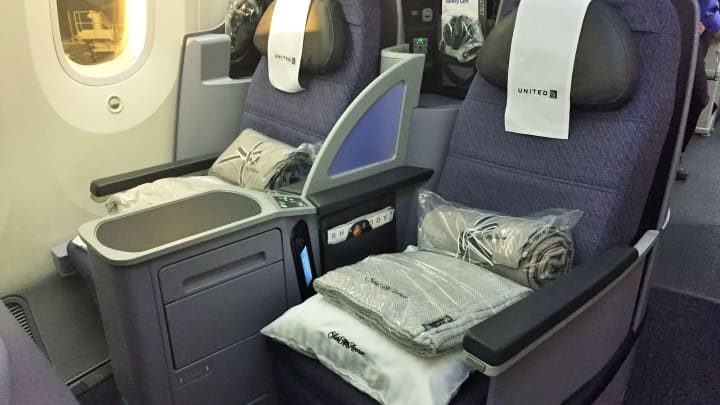 Business class fliers on United's LAX to Singapore flights benefit from Polaris amenities, including Saks Fifth Avenue bedding.