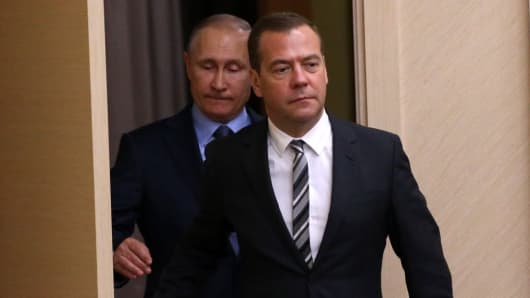 Russian and PM Dmitry Medvedev and President Vladimir Putin arrive at a meeting at Novo-Ogaryovo State Residence on July 28, 2017 outside of Moscow, Russia.