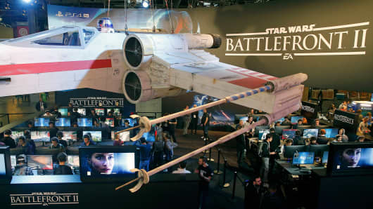 Gamers play the video game 'Star Wars Battlefront II' developed by DICE, Criterion Games and Motive Studios and published by Electronics Arts on Sony PlayStation game consoles PS4 Pro during the 'Paris Games Week' on October 31, 2017 in Paris, France.