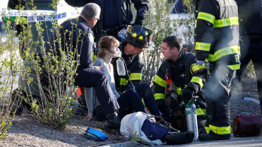 A woman is aided by first responders after sustaining injury on a bike path in lower Manhattan in New York, NY, U.S., October 31, 2017.