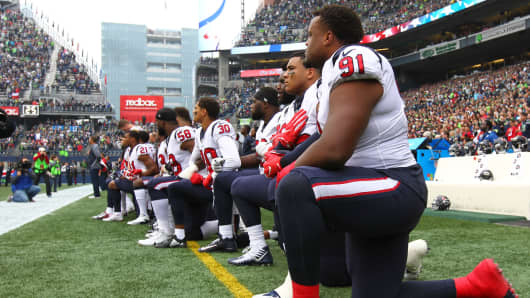 Members of the Houston Texans kneel during the national anthem before the game against the Seattle Seahawks at CenturyLink Field on October 29, 2017 in Seattle, Washington.