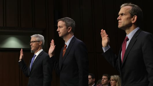 (L-R) Vice President and General Counsel for Facebook Colin Stretch, General Counsel for Twitter Sean Edgett, and Senior Vice President and General Counsel for Google Kent Walker are sworn in during a hearing before the Senate (Select) Intelligence Committee November 1, 2017 on Capitol Hill in Washington, DC.