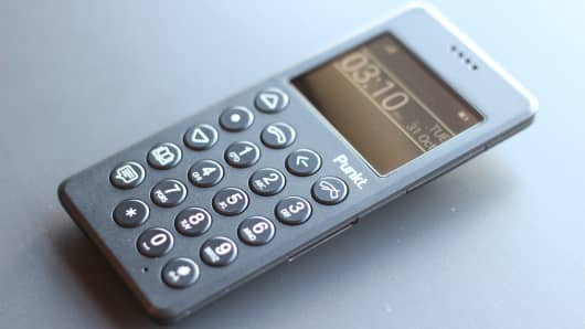 The Punkt mobile phone face includes a small, readable screen; full, physical number pad with offset navigation; shortcut keys to the left and a four-hole speaker grille near the top.