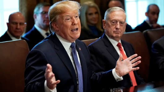 With Secretary of Defense James Mattis at his side, U.S. President Donald Trump speaks during a cabinet meeting at the White House in Washington, U.S., November 1, 2017.