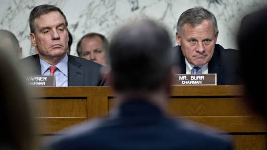 Senator Richard Burr, a Republican from North Carolina and chairman of the Senate Intelligence Committee, right, and ranking member Senator Mark Warner, a Democrat from Virginia, listen during a hearing on social media influence in the 2016 U.S. elections in Washington, D.C., U.S., on Wednesday, Nov. 1, 2017.
