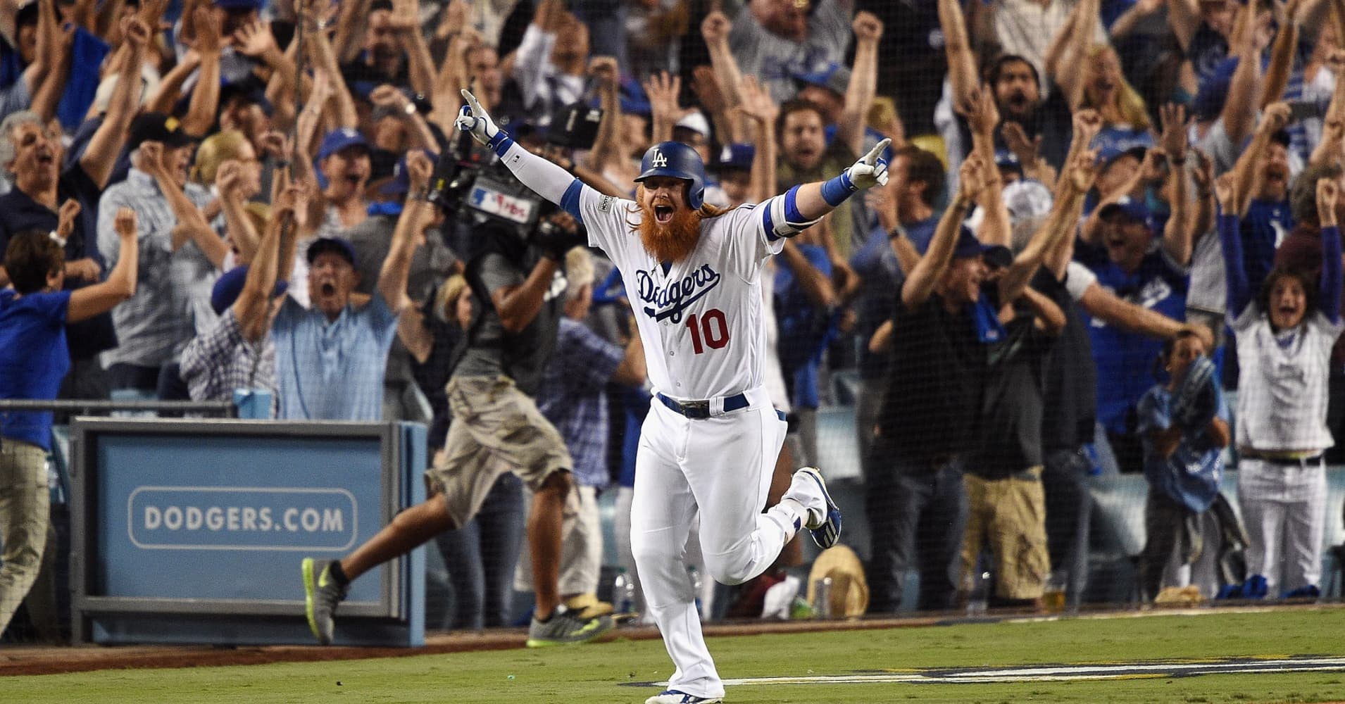 Justin Turner celebrates after hitting a walk-off homer to defeat the Chicago Cubs in game two of the National League Championship Series