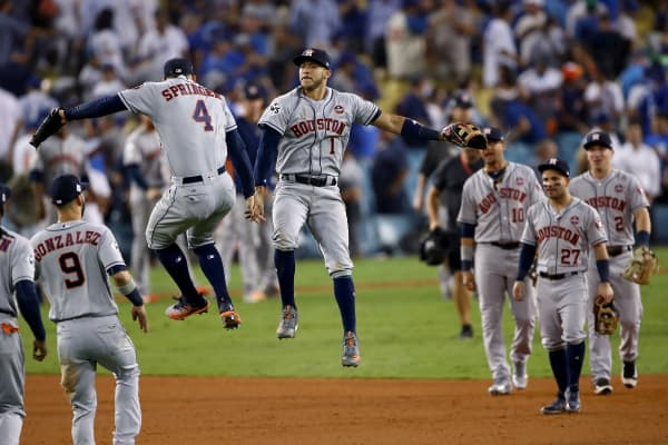 The Astros celebrate after defeating the Dodgers in eleven innings to win Game 2