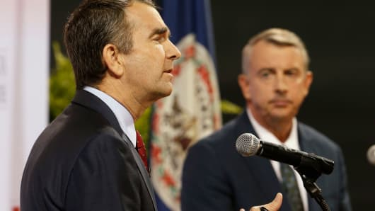 Democratic candidate for governor, Lt. Gov. Ralph Northam, left, gestures during a debate with Republican challenger Ed Gillespie at the University of Virginia-Wise in Wise, Va., Monday, Oct. 9, 2017.