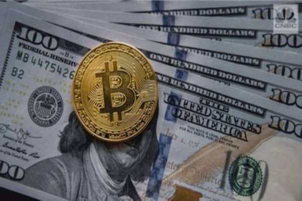Bitcoin soars past $7,000 to a new record high