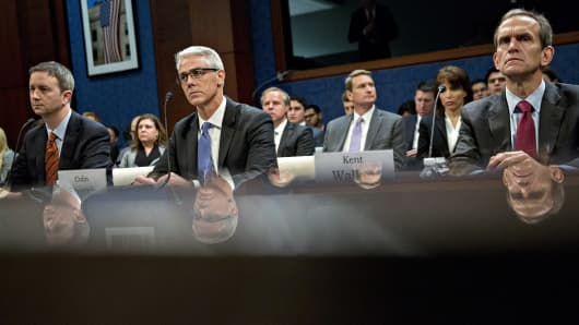 Kent Walker, vice president and general counsel with Google Inc., from right, Colin Stretch, general counsel with Facebook Inc., and Sean Edgett, acting general counsel with Twitter Inc., listen during a House Intelligence Committee hearing in Washington, D.C., U.S., on Wednesday, Nov. 1, 2017.