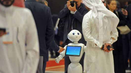 A Saudi man chats with a robot on the sidelines of the three-day Future Investment Initiatives conference in Riyadh, Saudi Arabia, on Oct. 25, 2017.