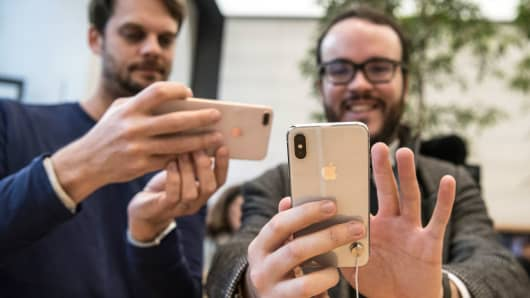 Customers check the new iPhone X upon its U.K release in the Apple store, on November 3, 2017 in London, England.