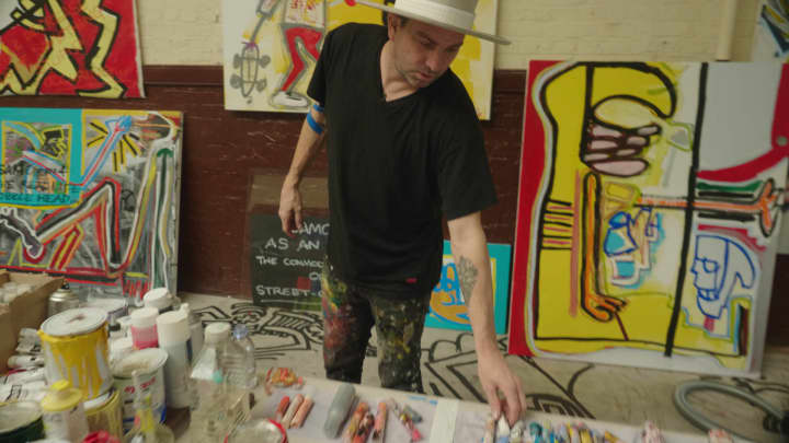 Artist Danny Minnick at work in a London studio.