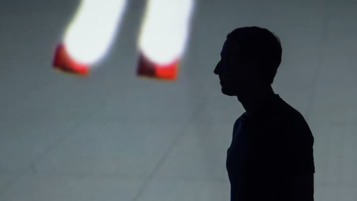 The silhouette of Mark Zuckerberg, chief executive officer and founder of Facebook Inc., is seen during the Oculus Connect 4 product launch event in San Jose, California, on Wednesday, Oct. 11, 2017.