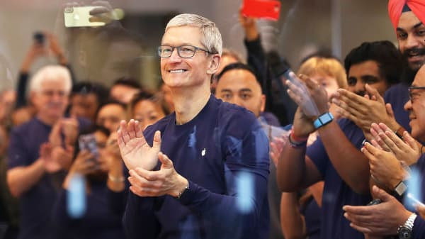 Apple CEO Tim Cook prepares to greet customers that will purchase a new iPhone X at an Apple Store in Palo Alto, California.