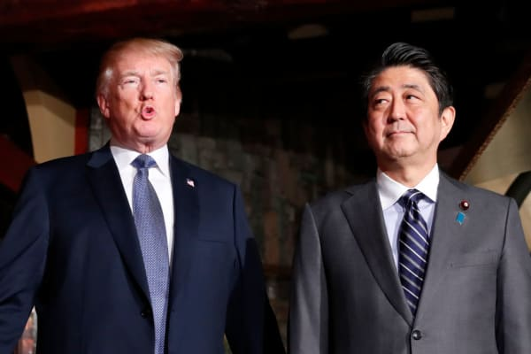 U.S. President Donald Trump and Japanese Prime Minister Shinzo Abe meet at a restaurant in Tokyo on Nov. 5, 2017.