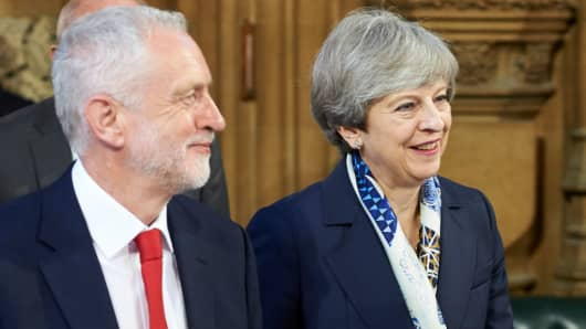 Britain's Prime Minister Theresa May (R) and Britain's main opposition Labour Party leader Jeremy Corbyn (L)