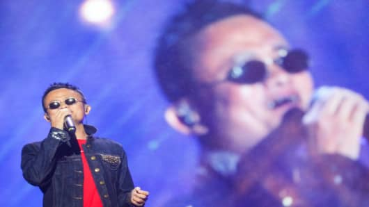 Jack Ma, Alibaba Group founder and executive chairman, singing a song during the Music Festival of the Computing Conference 2017 in Hangzhou in China's eastern Zhejiang province on Oct. 11, 2017.