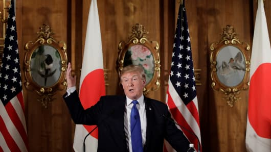 US President Donald Trump (C) and Japanese Prime Minister Shinzo Abe (not seen) hold a joint press conference after holding an inter-delegation meeting at Akasaka Palace in Tokyo, Japan on November 6, 2017.