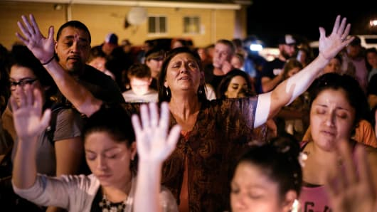 Michaun Johnson attends a candle light vigil after a mass shooting at the First Baptist Church in Sutherland Springs, Texas, U.S., November 5, 2017.
