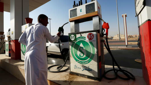 A man holds a nozzle at a petrol station in Riyadh, Saudi Arabia October 8, 2017.