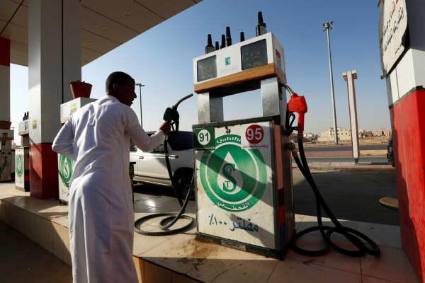 A man holds a nozzle at a petrol station in Riyadh, Saudi Arabia October 8, 2017.