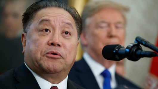 Broadcom CEO Hock Tan speaks as President Donald Trump listens during an event to announce the company is moving its global headquarters to the United States, in the Oval Office of the White House, in Washington.