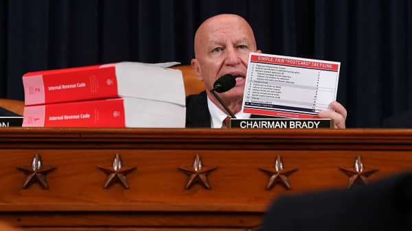 House Ways and Means Committee Chairman Kevin Brady (R-TX) holds up an example of the 'postcard-sized' form he wants people to use when filing their taxes during a markup session of the proposed GOP tax reform legislation in the Longworth House Office Building on Capitol Hill November 6, 2017 in Washington, DC.