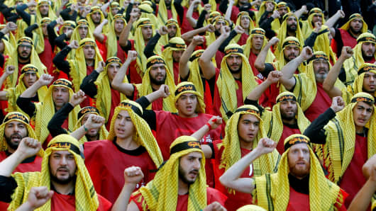 Supporters of Lebanon's Hezbollah party parade to mark the last day of Ashura ceremony in Beirut.
