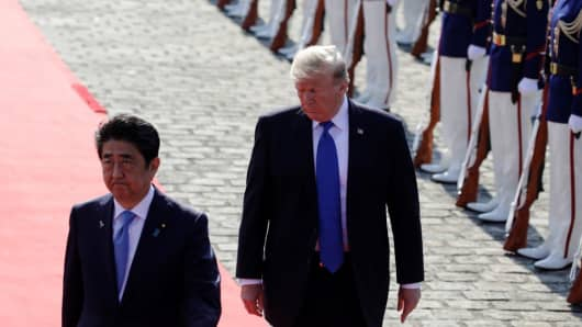 U.S. President Donald Trump and Japanese Prime Minister Shinzo Abe walk past honor guards at Akasaka Palace in Tokyo, Japan on November 6, 2017