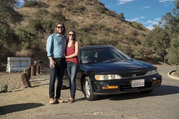 "Max Lanman and Carrie Hollenbeck with their 1996 Honda Accord, ""Greenie"""