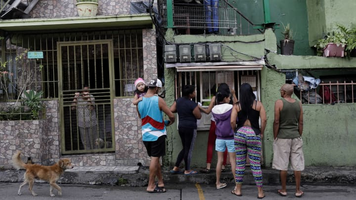 "People wager money on ""Los Animalitos"" on the outskirts of Caracas. ""In a crisis like the one we're going through, people drink and gamble more to escape from reality,"" said psychologist Rosa Garcia from the rural state of Barinas."