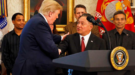President Donald Trump introduces Broadcom CEO Hock Tan prior to Tan announcing the repatriation of his company's headquarters to the United States from Singapore during a ceremony in the Oval Office of the White House, in Washington, DC, November 2, 2017.