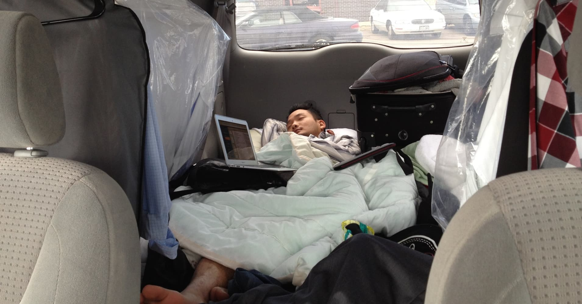 Kevin Hong asleep in his van