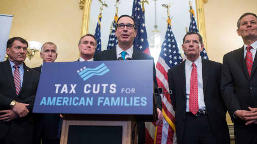Treasury Secretary Steven Mnuchin speaks during a news conference in the Capitol where GOP senators said families and small businesses would benefit from tax reform on November 7, 2017.