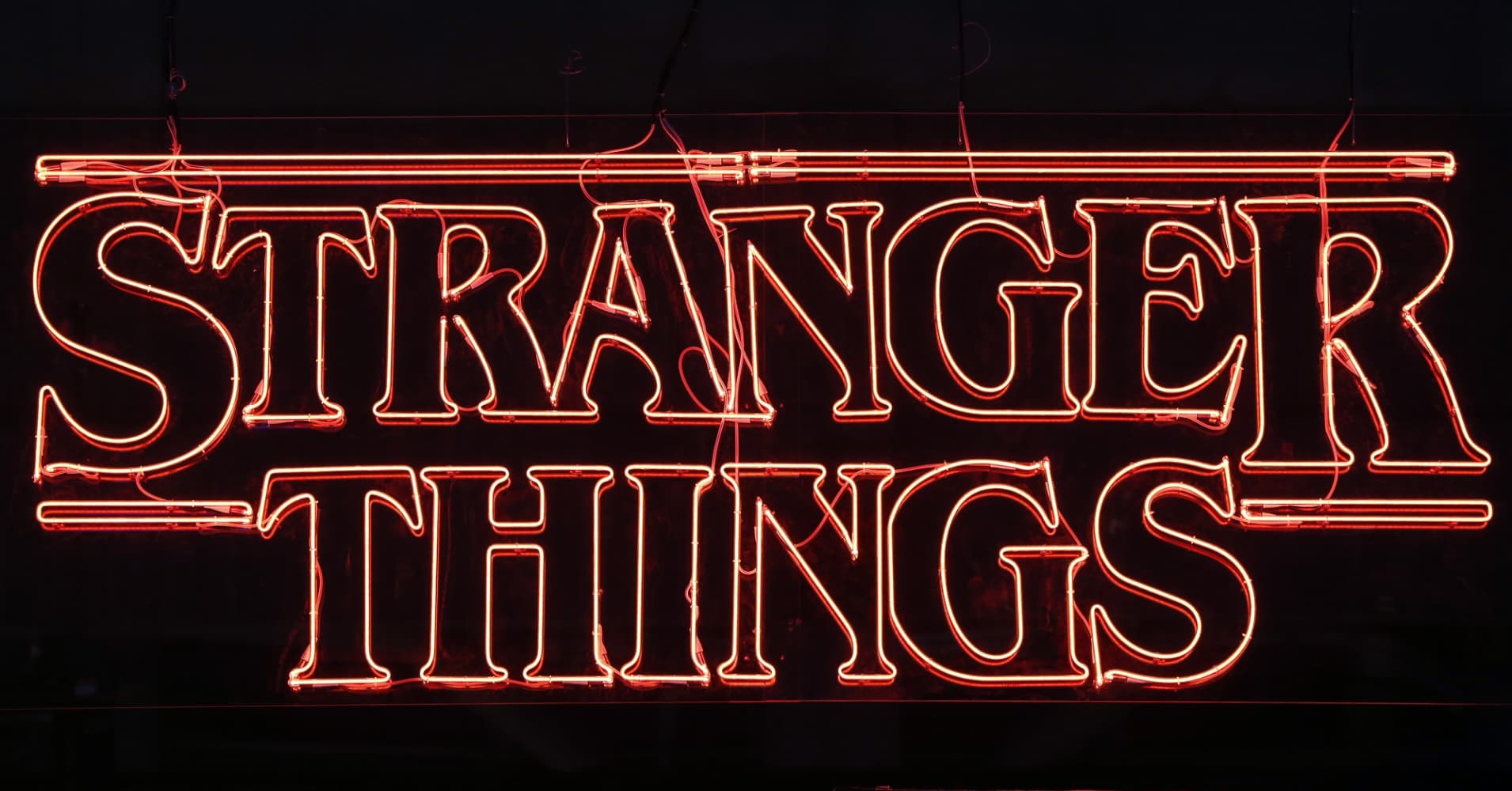 "Television series logo ""Stranger Things"" is displayed during the 'Paris Games Week' on October 31, 2017 in Paris, France."