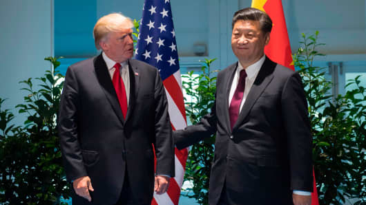 President Donald Trump and Chinese President Xi Jinping (R) arrive prior to a meeting on the sidelines of the G20 Summit in Hamburg, Germany, July 8, 2017.