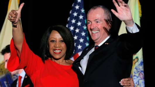 Democratic candidate Phil Murphy celebrates with his running mate, Lieutenant Governor-elect Sheila Oliver, after he was elected Governor of New Jersey, in Asbury Park, New Jersey, U.S., November 7, 2017.