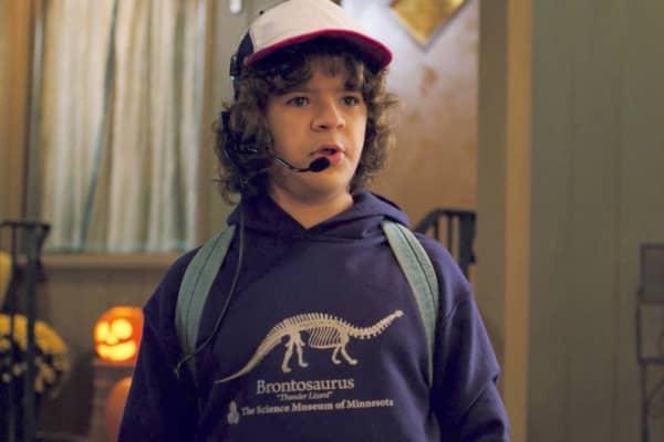 Stranger Things' Dustin wearing a Brontosaurus sweatshirt crashes website.